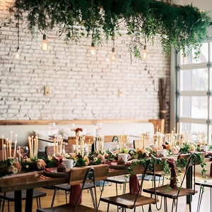Cozy Winter Wedding Reception with Exposed Brick and Hanging Greenery