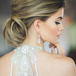 Elegant Bridal Chignon with a Beaded Illusion Back Wedding Dress