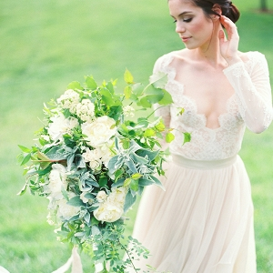 Long Sleeve Lace Wedding Dress with a Greenery Bouquet