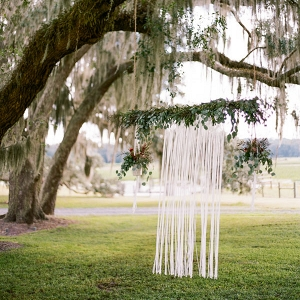 Rustic Ceremony Backdrop with Hanging Ribbons