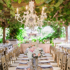 Sparkling Reception Tables under a Crystal Chandelier