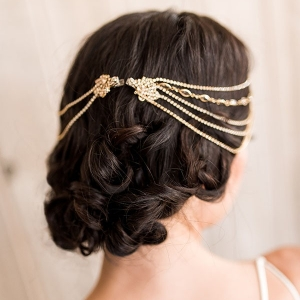Loose and Elegant Bridal Updo with a Jeweled Headpiece