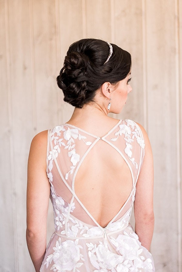 Elegant Bridal Updo with a Keyhole Back Wedding Dress