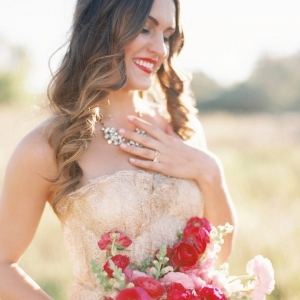 A Gold Wedding Dress and Bright Pink Bouquet