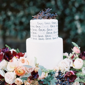Love Letter Wedding Cake with a Floral Wreath