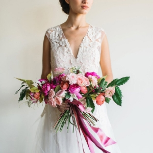 Dreamy Lace and Tulle Wedding Dress with a Modern Pink Bouquet