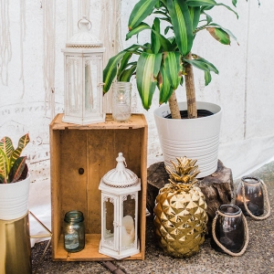 white-lanterns-gold-pineapples-potted-greenery