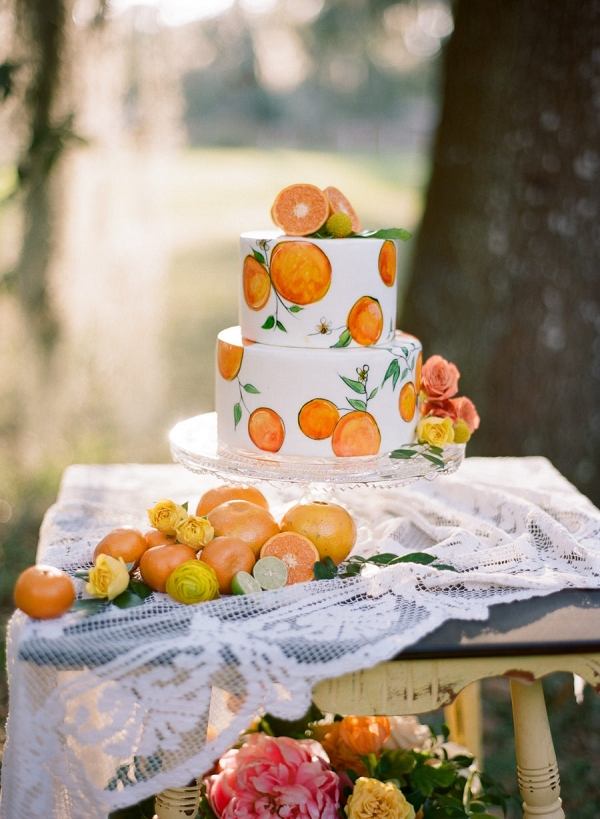 Hand-Painted Wedding Cake with Orange Citrus Cake Topper on Vintage and Lace Table
