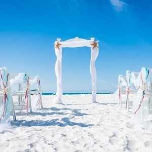 Florida Beach Wedding Ceremony Altar with White Draped Linen and Starfish