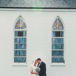Bride and Groom Wedding Portrait in front of White Church with Stained Glass | Ybor City Wedding Church Venue Amazing Love Ministries