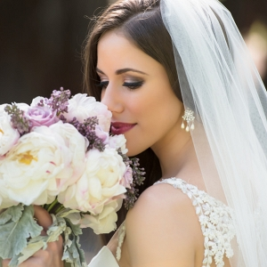 Outdoor, Bridal Wedding Portrait in Lace Wedding Dress and Veil and Purple and White Rose and Lilac Floral Wedding Bouquet of Flowers