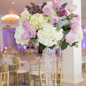 Elegant, Romantic Purple, Ivory, Lilac and White Rose and Hydrangea Floral Centerpieces with Dripping Rhinestone Crystals at Wedding Reception
