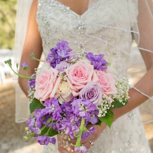 Bridal Wedding Portrait in Ivory, Beaded Lace Wedding Dress and Pink and Purple Bouquet of Flowers