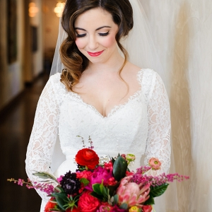 Bright Pink and Red Wedding Bouquet and Bride in Mikaella Bridal Lace Wedding Dress with Sleeves