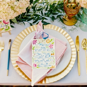 Wedding Reception Place Setting with Gold Charger and Gold Silverware with Watercolor Menu Card with PersonalIzed Cookie Favor with Name Card and Hydrangea Floral Decor