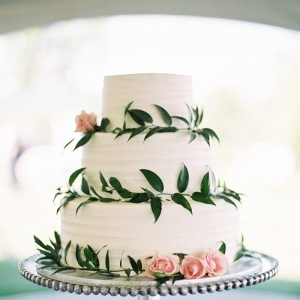 simple rustic wedding cake with pink rose and greenery details