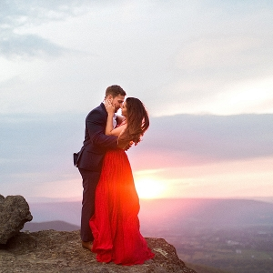 Romantic mountaintop engagement session on Mountainside Bride