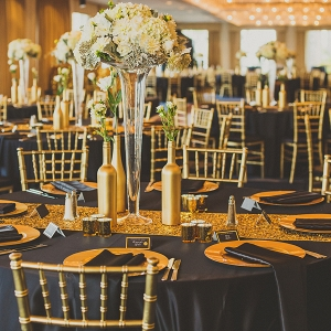 Black and gold ballroom reception