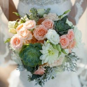 Romantic peach rose and succulent bridal bouquet
