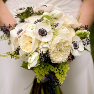 Cream and navy blue wedding bouquet with anemone and peonies