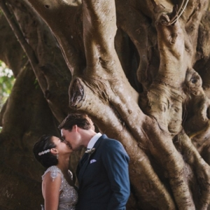 The Bride and Groom Under A Magnolia Tree