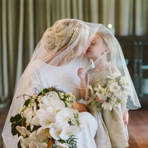 Bride Kissing Flowergirl