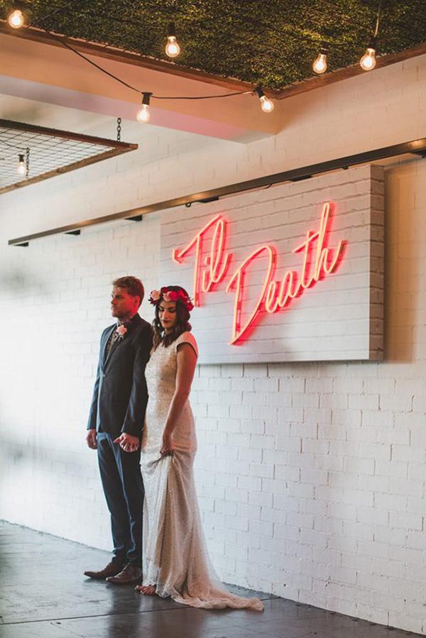 Neon Wedding Sign With Newlyweds