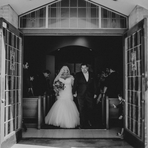 Elegant Navy and Gold Fiesta in Texas featuring a plus size bride and her dapper groom