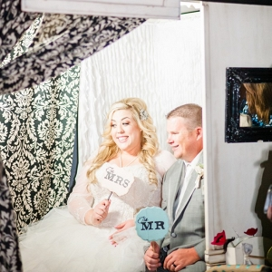 Plus Size Bride and Groom in Photobooth