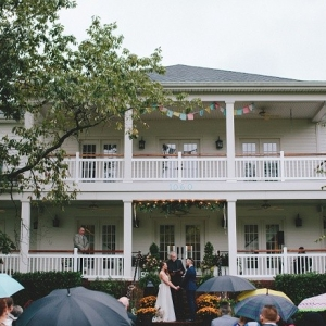 Wedding ceremony in front of a beautiful southern home on a lake.