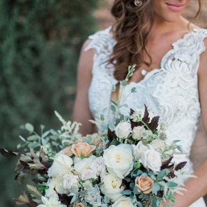 Bride in Lace Dress with Bouquet