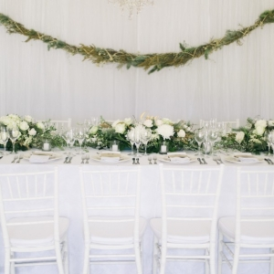 Classic tables with greenery garlands