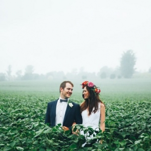 Boho bride and groom in misty field
