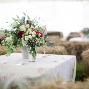 Marquee Reception with Hay Bales and Floral Print Linens