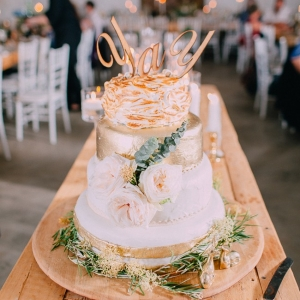 Gold wedding cake with 'yay' topper