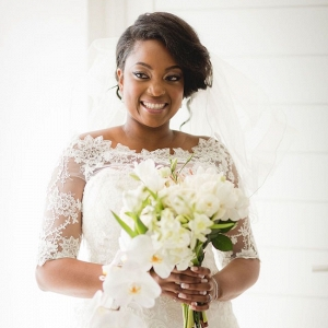 Bride in Lace Sleeve Dress with White Bouquet