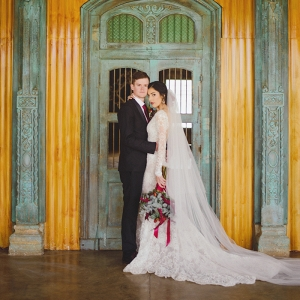 Bride and Groom with Ornate Door Background