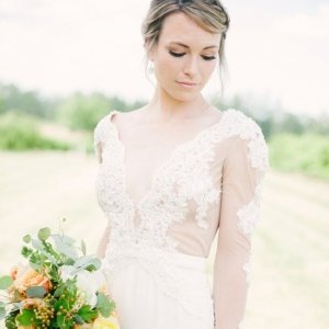 Bride in lace sleeve dress