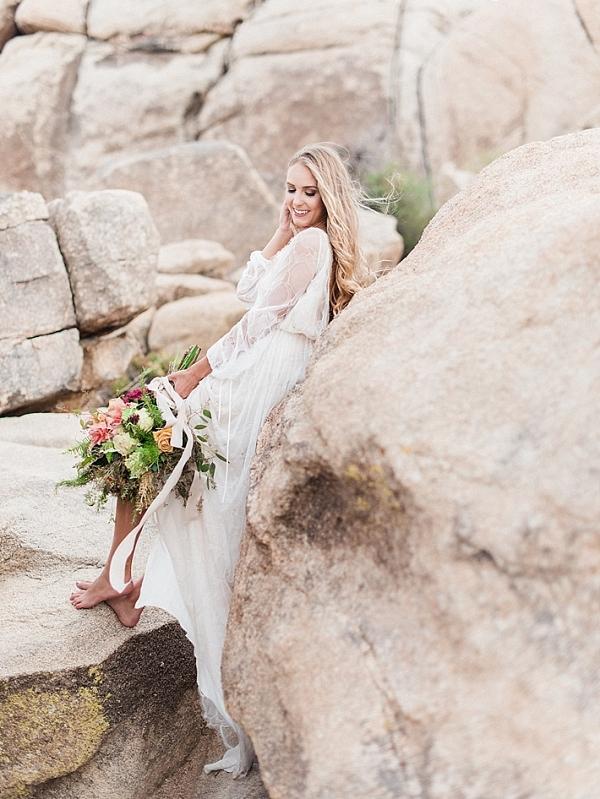 Bride in flowy white wedding dress in the desert