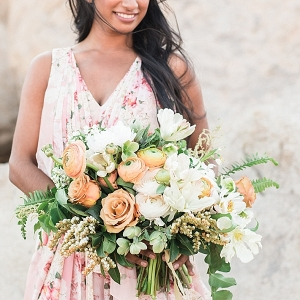 large peach and white floral bouquet with roses, tupils, ferns, and ranunculus