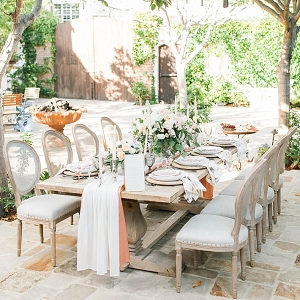 Romantic Tablescape with linen runner and candles at The Villa San Juan Capistrano