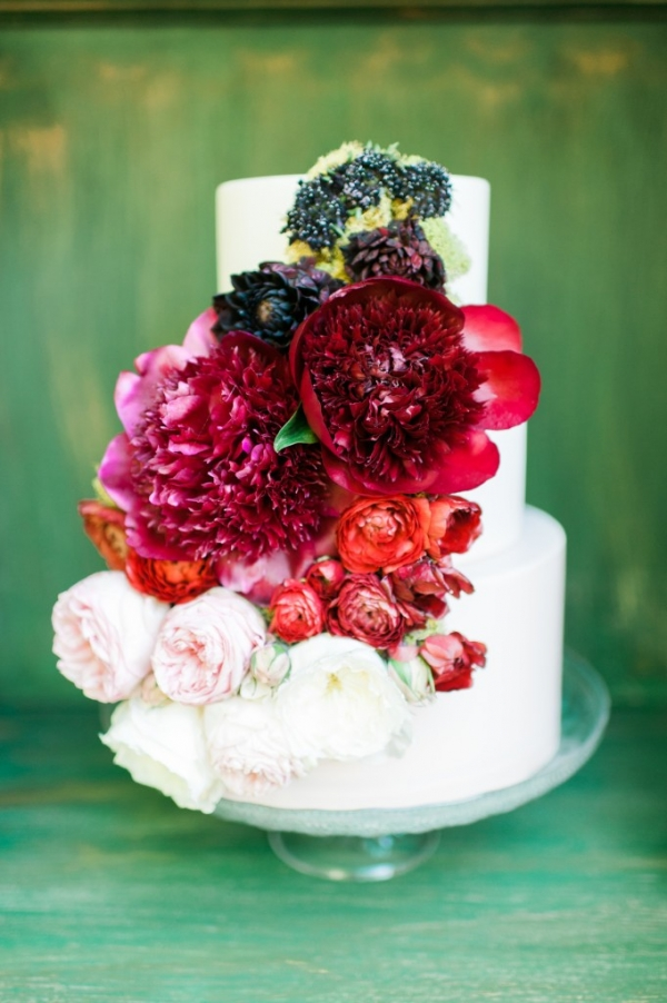 Organic wedding cake adorned with peonies and roses