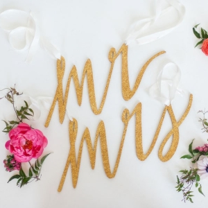 Mr. and Mrs. chair signs made out of glittered birch wood