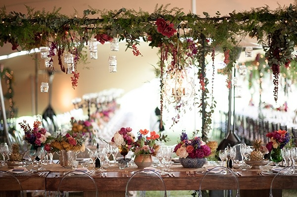 Eclectically romantic winery wedding reception with suspended greenery