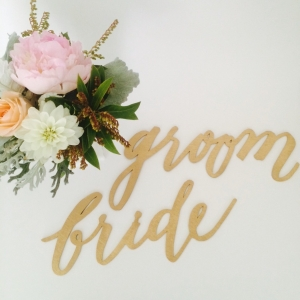 Laser-cut bride and groom chair signs