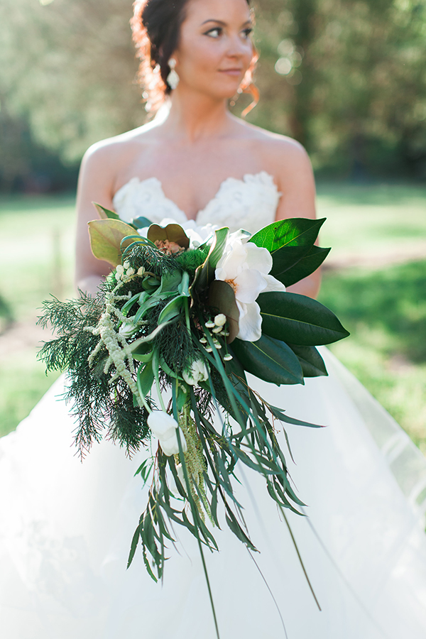 Southern bouquet with magnolias, tulips, and trailing greenery