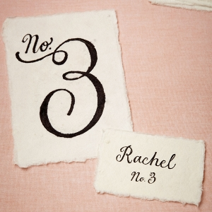 Mulberry bark place cards and table numbers with torn edges