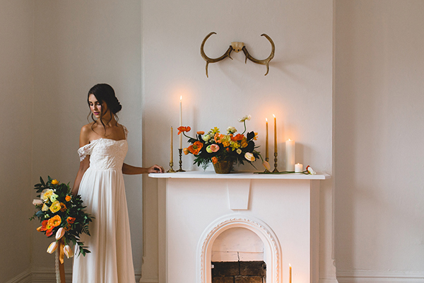 Fireplace altar with poppies and candles