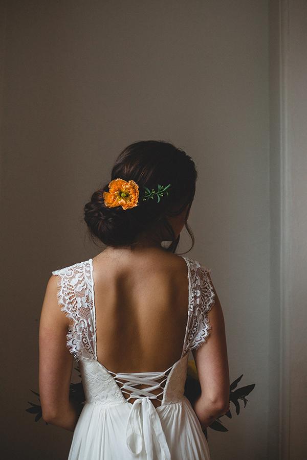 Chic chignon adorned with an orange poppy