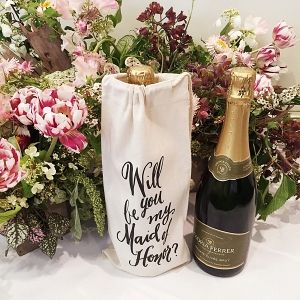 A calligraphed wine bottle tote for asking your best friend to be your maid of honor